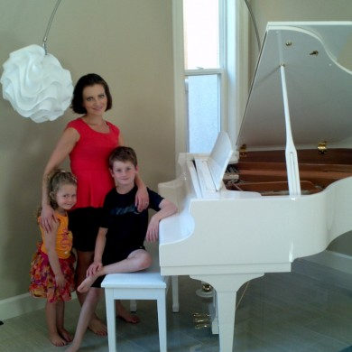 Laura Roytman with her new piano from Piano Megastore