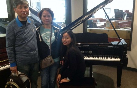Karen Yuan's family with their new Perzina Grand Piano (Magic Lid installed)