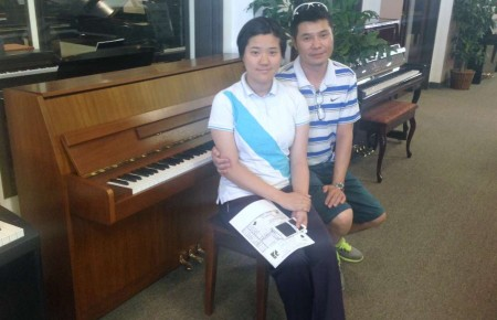The Lius family and their Kawai Console
