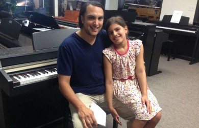 Fahim and his daughter with their Kurzweil Digital Piano