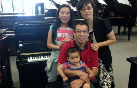 The Zhong Family with their new Hallet Davis piano.