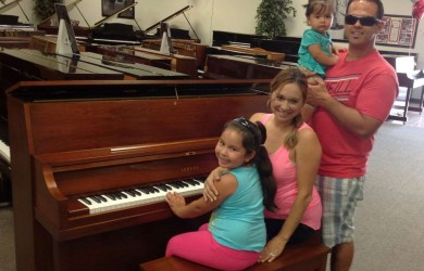 Robert, Lily and Family and their Yamaha Studio Piano.