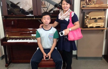 Wang and her son with their new Starr Piano