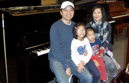 The Vu Family and their Yamaha Studio Piano