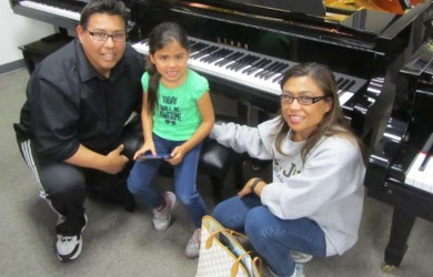 The Baez family and their new Starr Baby Grand