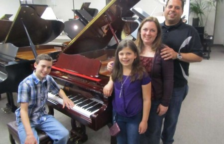 The Principato Family and their new Perzina Queen Anne Grand Piano.
