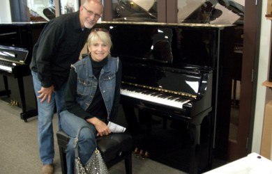 The Becketts with their new Kingsburg Piano
