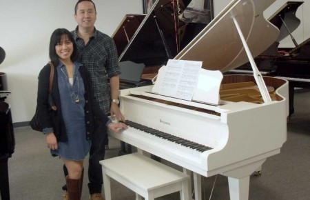 The Nguyens and their Bergmann Baby Grand Piano