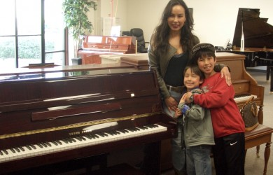 Mytien and family with their Young Chang console